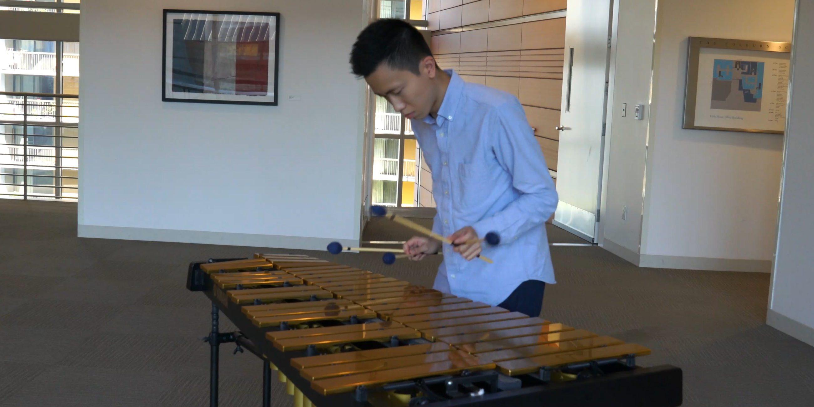 Tsz-Ho Samuel Chan playing marimba.