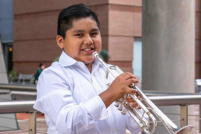 Erre Maqueos playing trumpet.