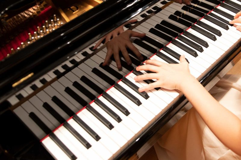 Photo of pianist's hands on a concert piano