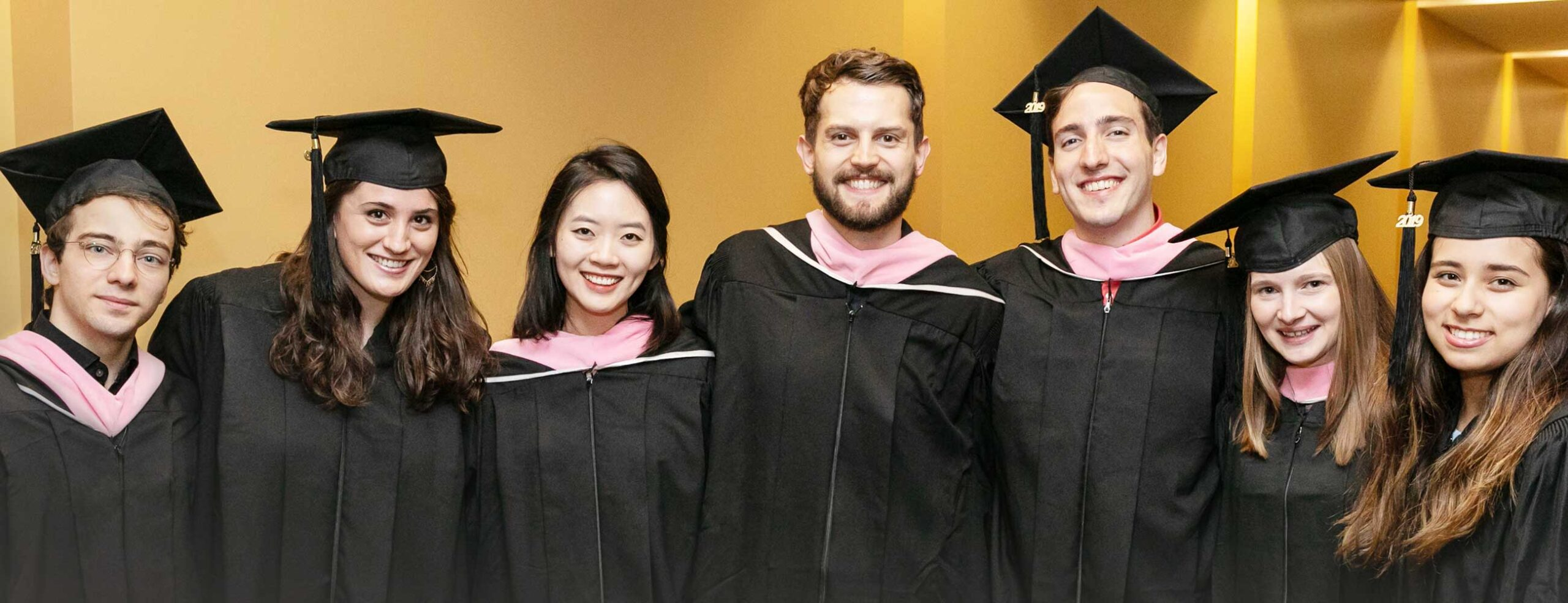 Conservatory students in caps and gowns