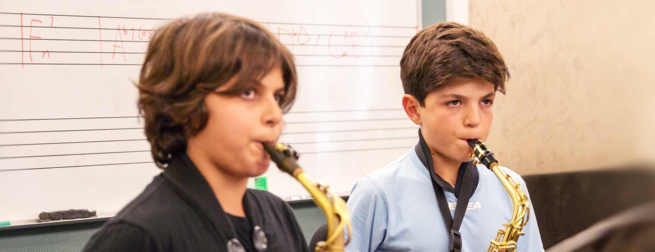 Boys playing saxophone