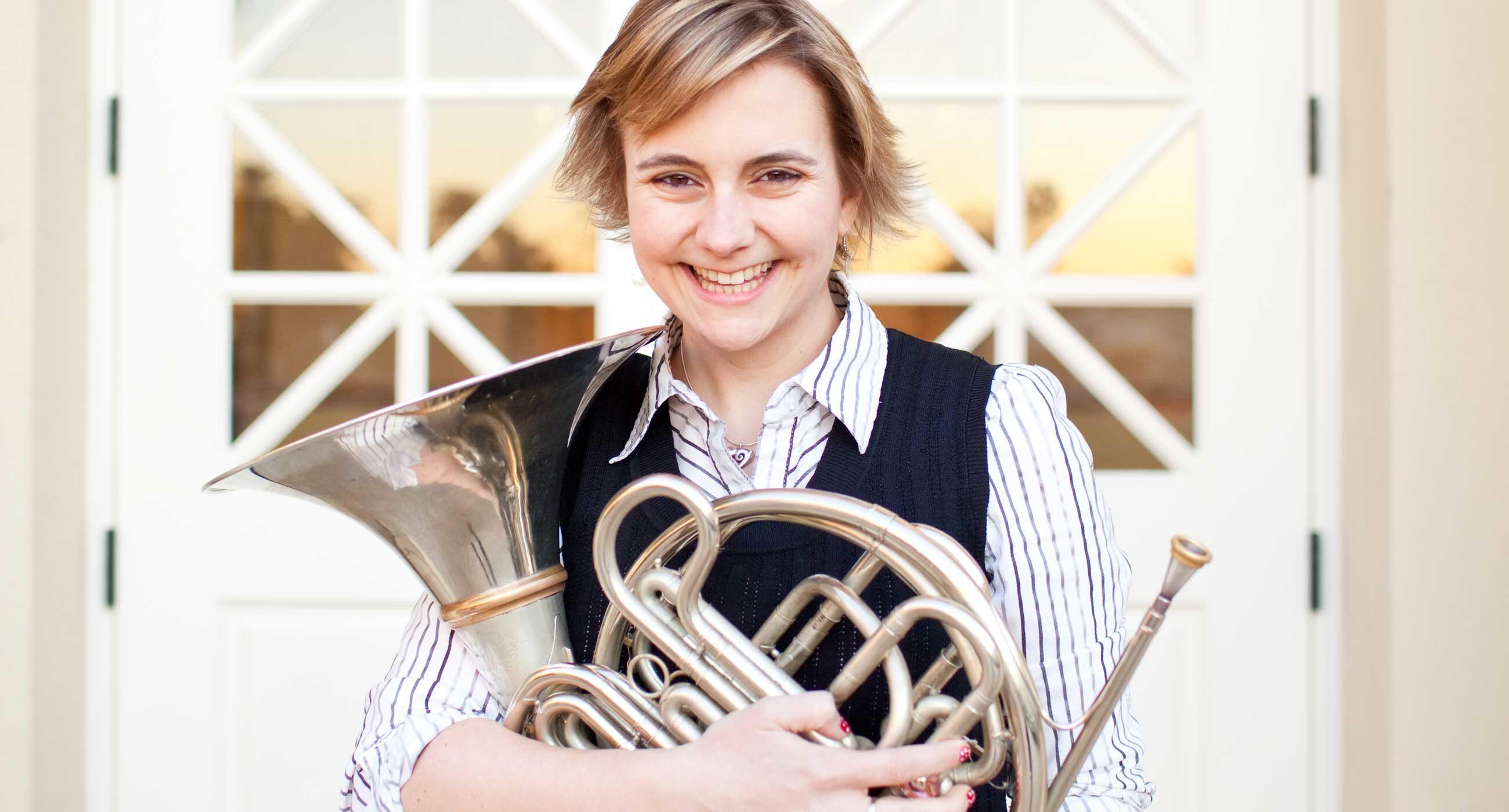 Headshot of Annie Bosler holding a horn