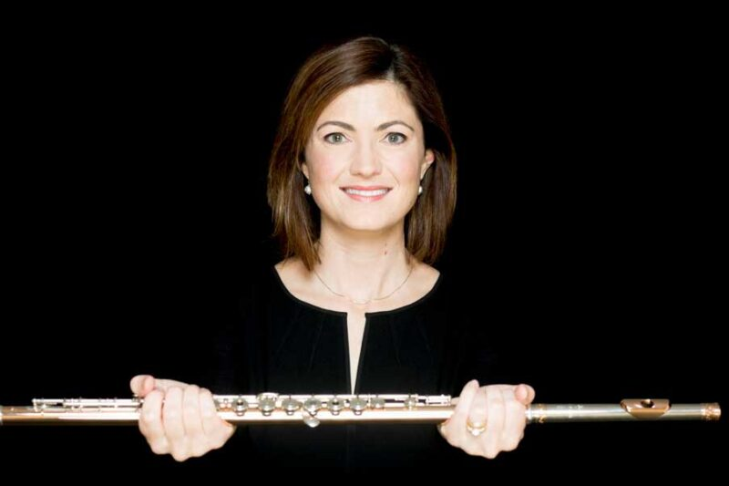 Elizabeth Rowe holding a flute