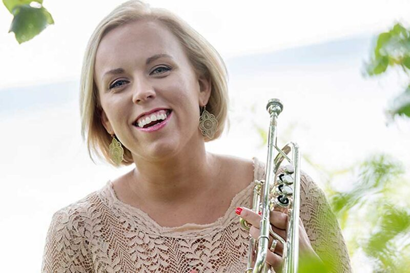 Tine Thing Helseth smiling and holding a trumpet