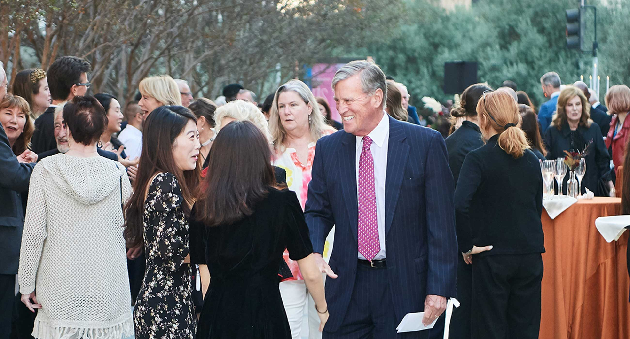 Donor Bill Kennedy talks to Colburn faculty at a reception