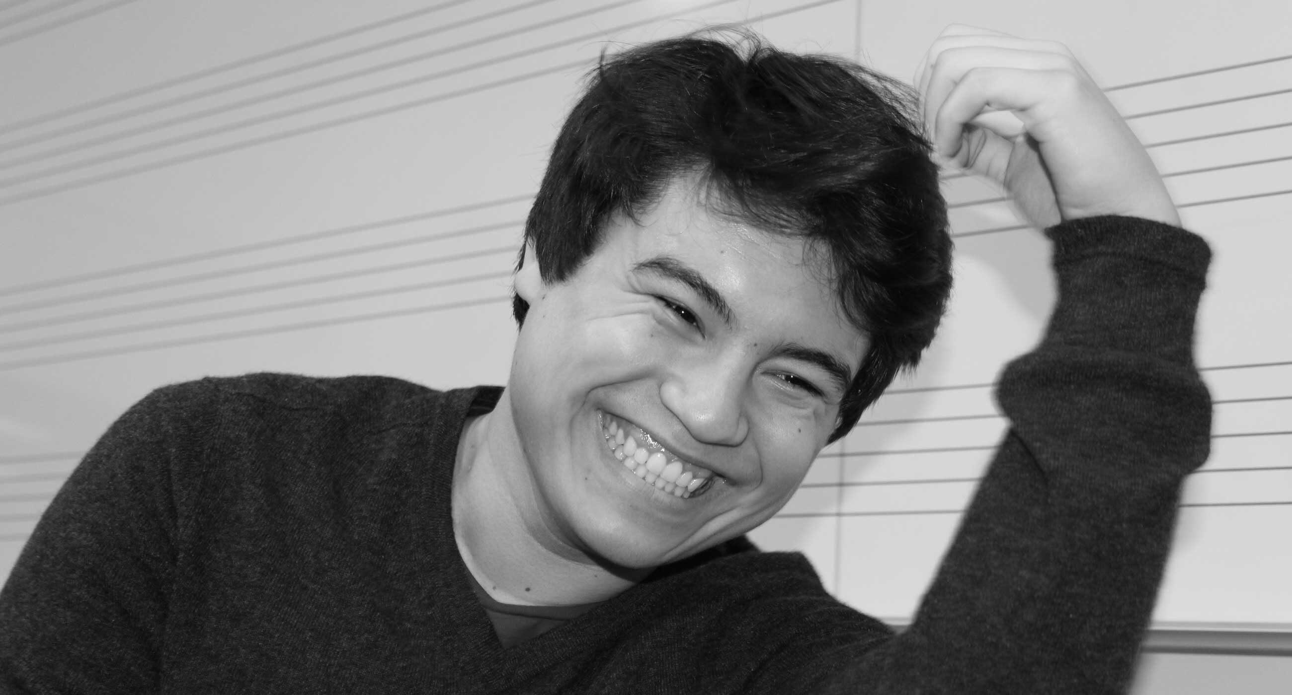 Black and white photo of Sam Glicklich smiling