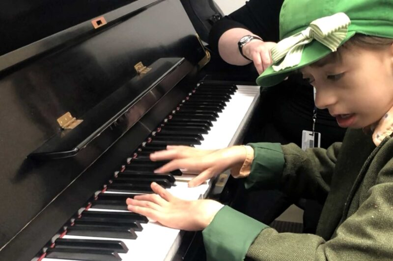 Grace Rosewood playing piano