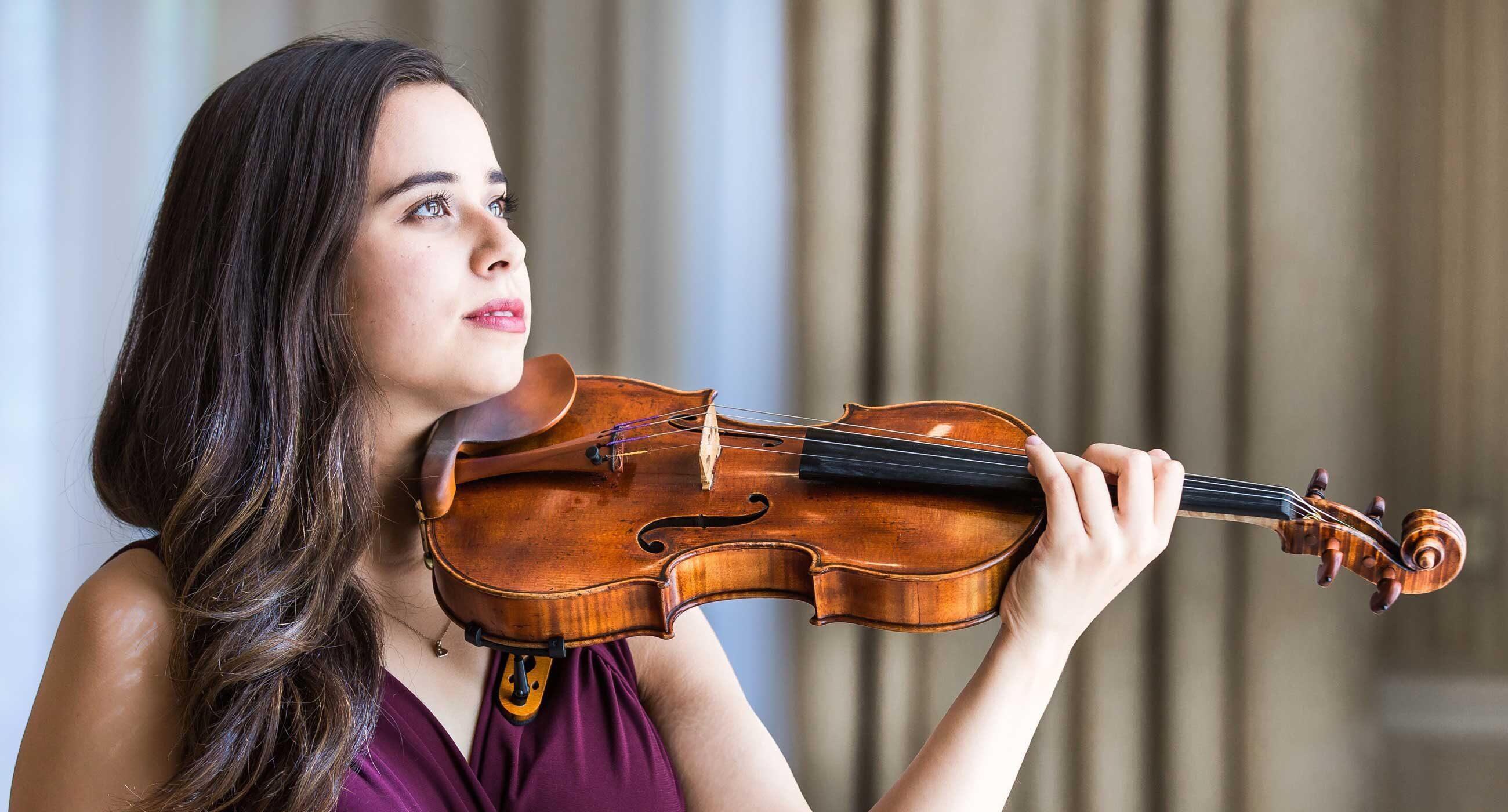 Gallia Kastner holding a violin