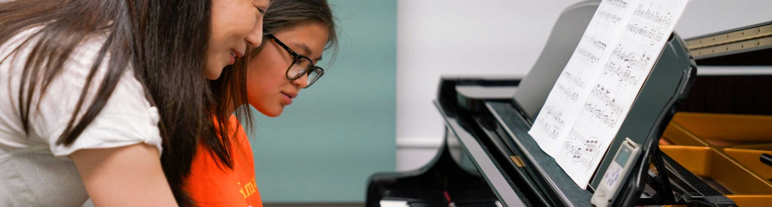 Student and teacher at piano