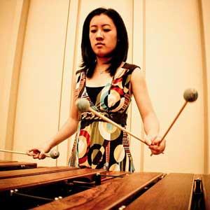 Christina Cheon playing a marimba