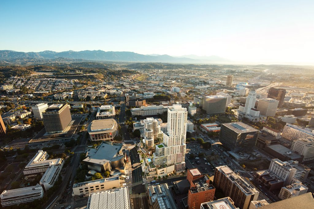 Aerial view of The Grand building in DTLA at sunrise with mountains in the background
