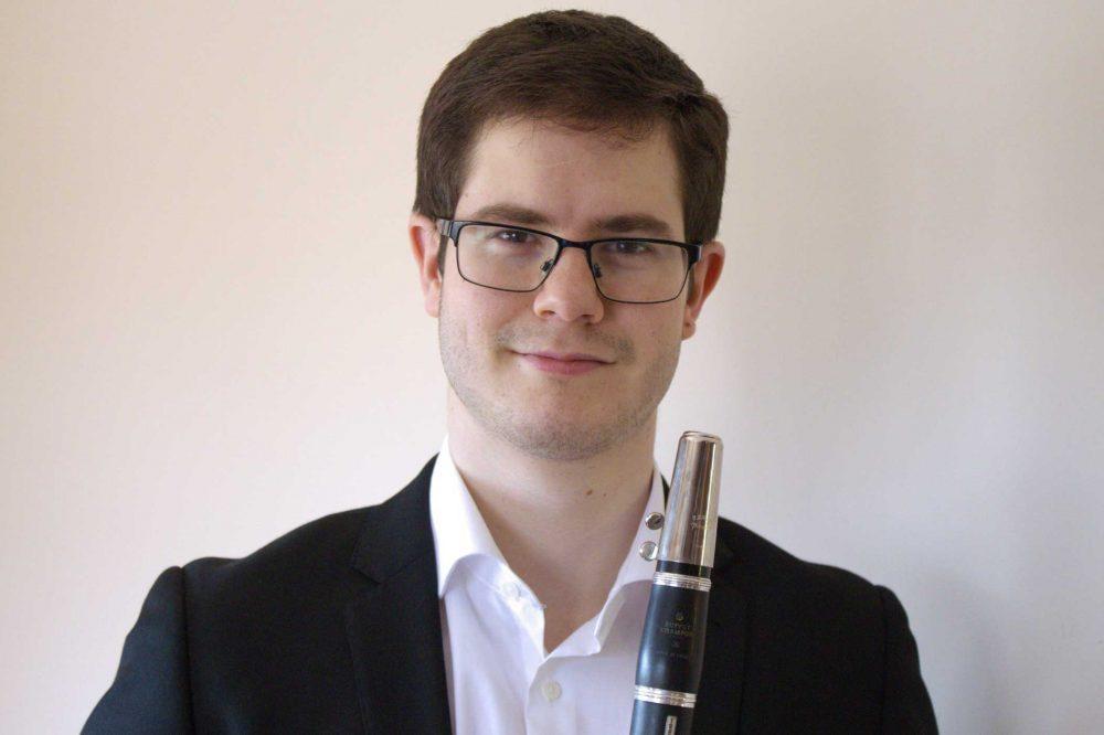 Ángel Martín holding a clarinet
