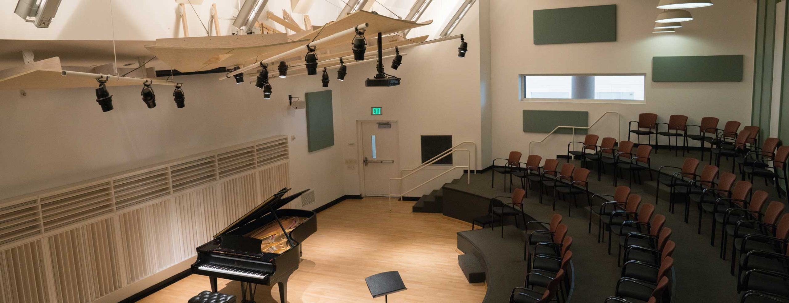 Overhead view of Mayman Hall with piano and empty lecture seats