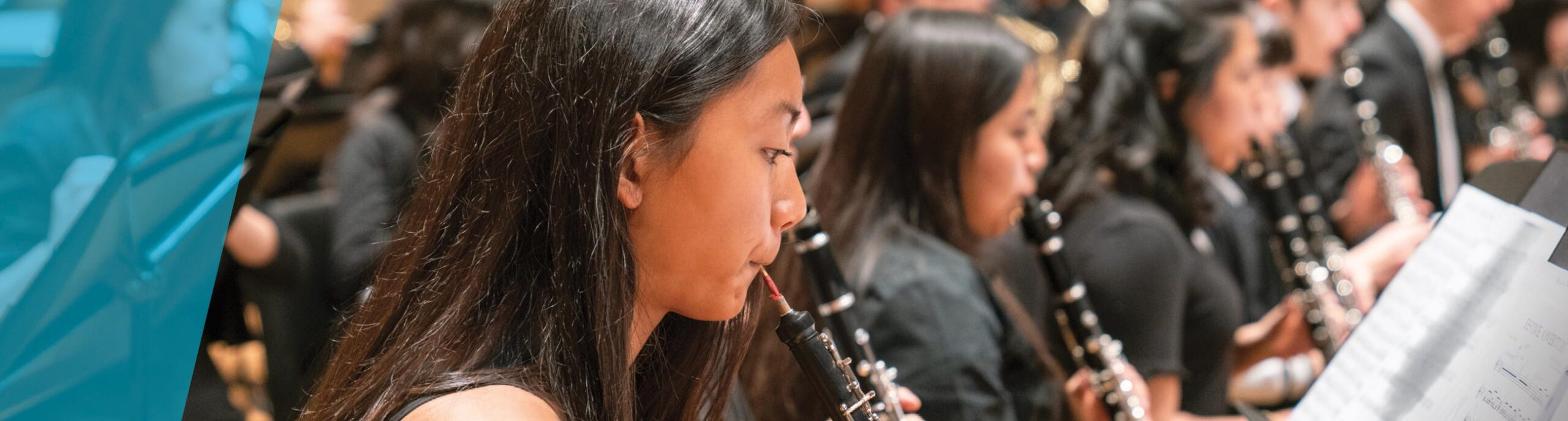 Oboe players on stage in a row