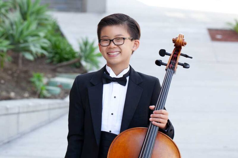 Young student in tuxedo with cello